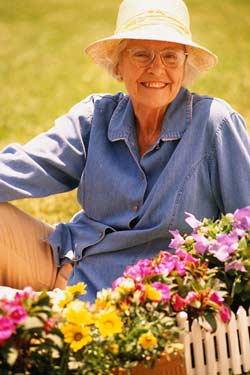 Elderly woman in garden